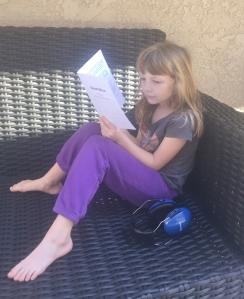 Megan reading Dead Mice